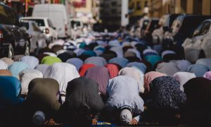 people kneeling and praying during daytime
