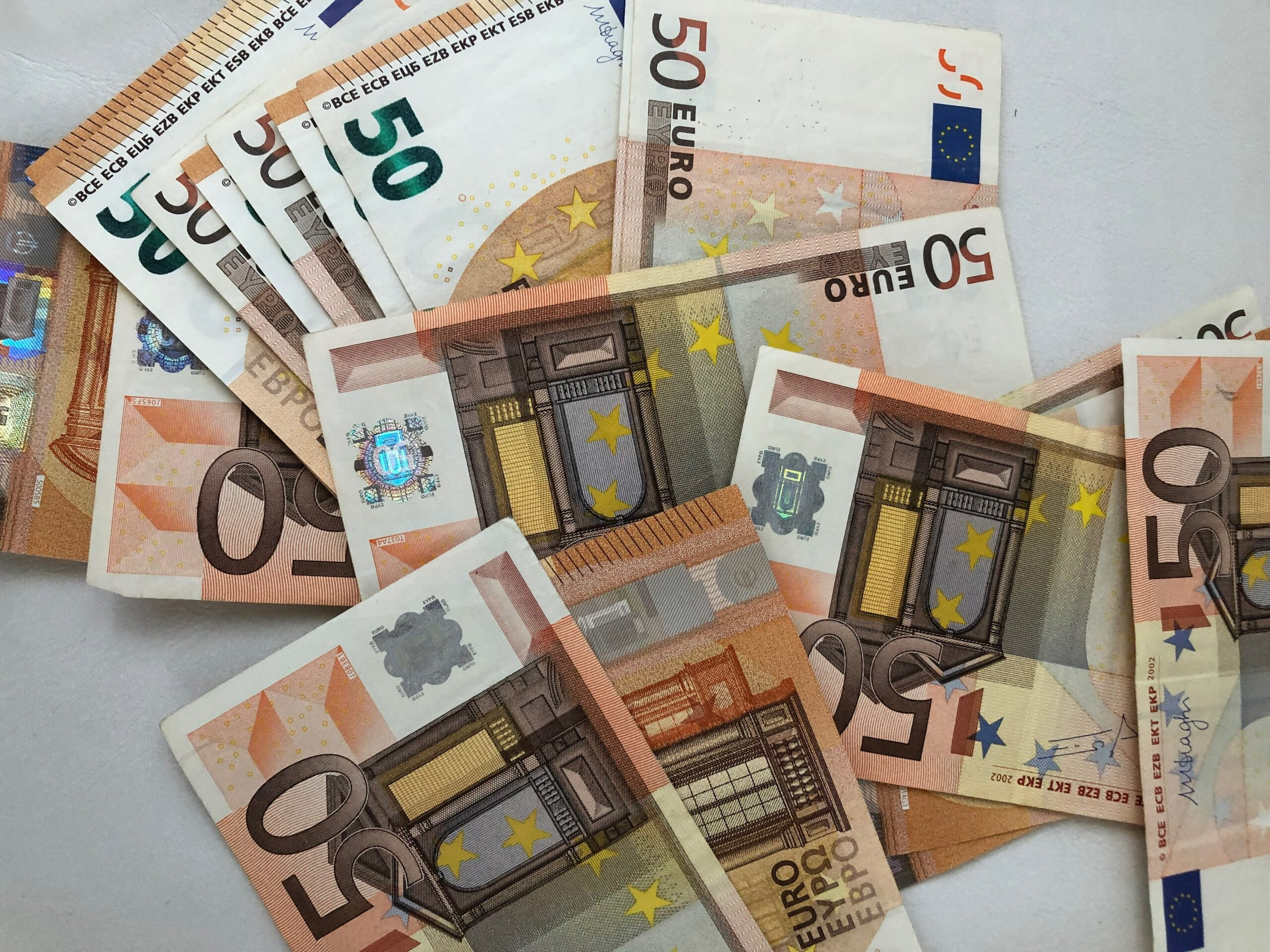 50 euro banknote lot on white surface