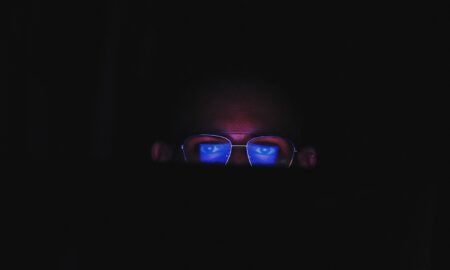 person wearing black framed eyeglasses