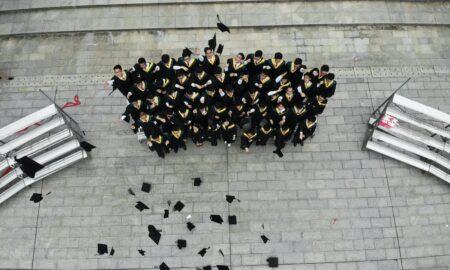 group of graduates throwing academic hats