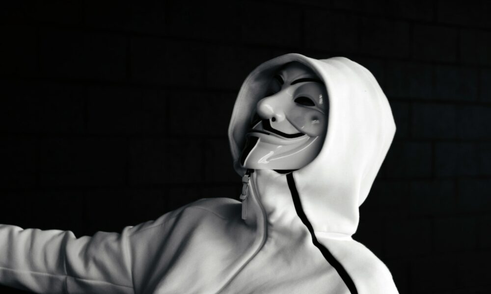 person wearing jacket and mask